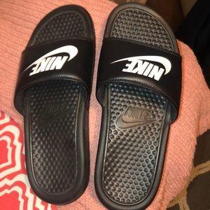 Black Nike slides